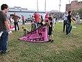 WWOZ 30th Parade Elysian Fields Lineup Steppers Banner Kids.JPG