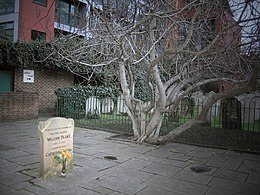 William Blake's grave with flower.jpg