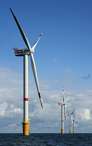 Sustainable development - Wind powers 5 MW wind turbines on a wind farm 28 km off the coast of Belgium.