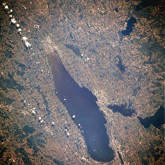 Lake Winnebago - From space (July 1996). The string of clouds in the upper left of the image runs almost perfectly north-south, with north being at the bottom of the image.