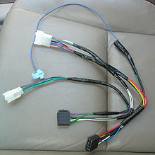 220px Wire_harness_for_aftermarket_head_unit cable harness wikipedia Wire Harness Clips at gsmportal.co