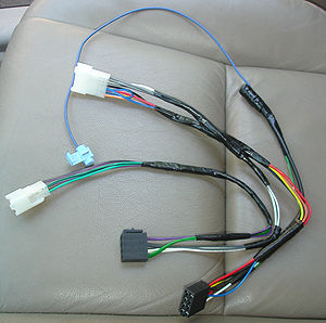 Wire harness for adapting speaker wires in car...