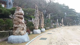 Cave rocks align the rock landscape next to the sports field in Wolmyeongdong
