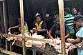 Women plucking chickens in a market.jpg