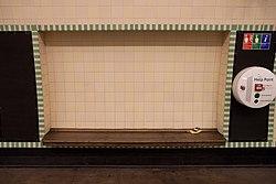 WoodGreen - Bench on eastbound platform after (4570674137).jpg