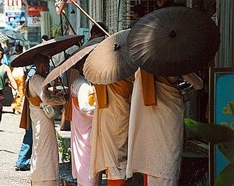Thilashin - Thilashin during alms round in Yangon, Myanmar (Burma).