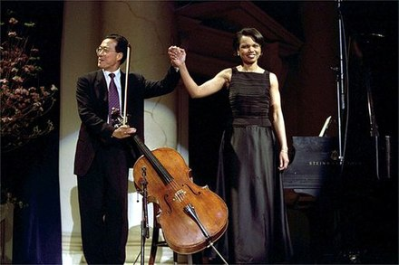 Ma with Condoleezza Rice after performing a duet at the presentation of the 2001 National Medal of Arts and National Humanities Medal Awards. Yoyoma rice.jpg