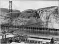 """""""Suspension bridge for transporting sand and gravel to the west side mixing plant. The two spans shown here are each... - NARA - 294007.tif"""