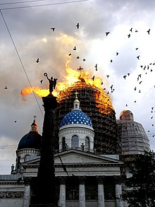 The cathedral with the main dome on fire