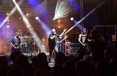 https://upload.wikimedia.org/wikipedia/commons/thumb/f/fa/02015_Konzert_der_Band_IRA_%28Rockmusik%29.jpg/240px-02015_Konzert_der_Band_IRA_%28Rockmusik%29.jpg