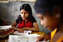 "10 years old Dipa and 12 years old Laboni study in class 2 at ""Unique Child learning Center"", Mirmur-Dhaka, Bangladesh.jpg"