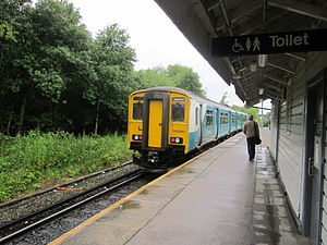 Bidston railway station - An Arriva Trains Wales service, waiting to depart from platform 2. The platform is also used by Merseyrail services to West Kirby