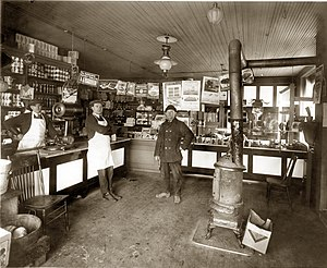 Wood-burning stove - Wood-burning stove heating a grocery store in Detroit (1922)