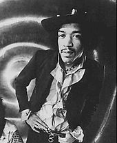Black-and-white picture of Jimi Hendrix standing