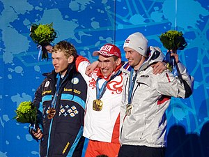 2010 Winter Paralympics medal table - From left to right: Grygorii Vovchynskyi of the Ukraine (bronze), Kirill Mikhaylov of Russia (gold), and Nils-Erik Ulset of Norway (silver) with the medals they earned in men's pursuit in biathlon.