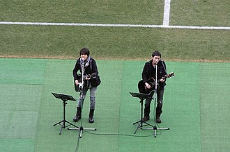 Yuzu (band) - Yuzu performing in 2012. From left to right: Yūjin Kitagawa, Kōji Iwasawa