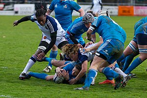Women's rugby union - Italian and French players rucking during 6 nations 2014