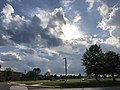 2020-06-10 18 12 04 Sun and cumulus clouds along Lees Corner Road in the Franklin Farm section of Oak Hill, Fairfax County, Virginia.jpg
