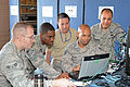 290th 'B-Flight' troubleshoot JBlox baseband equipment 150503-Z-TY576-004.jpg