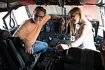 2999747 Actors Kurt Russell and Kate Hudson sit in the cockpit of a WC-130J Super Hercules.jpg