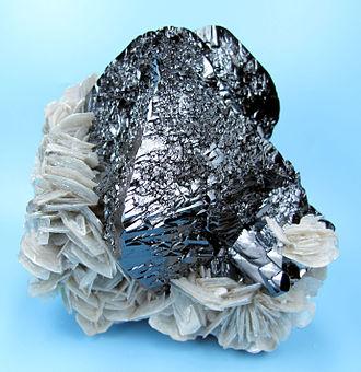 Cassiterite - Cassiterite with muscovite, from Xuebaoding, Huya, Pingwu, Mianyang, Sichuan, China (size: 100 x 95 mm, 1128 g)