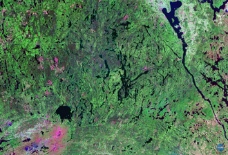Temagami Magnetic Anomaly - Landsat image showing the Anomaly, cross is at the centre of it. Shows the terrain only, not the magnetic deviations of the area.