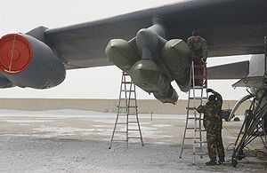 2007 United States Air Force nuclear weapons incident - An AGM-129 pylon is loaded onto the wing of a B-52 at Minot.