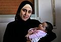A Syrian refugee and her newborn baby at a clinic in Ramtha, Jordan (9613483141).jpg