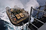 A U.S. Navy Landing Craft Air Cushion, more commonly known as an LCAC, approaches the well deck of the amphibious assault ship USS Bonhomme Richard (LHD 6) as the ship operates in the East China Sea on Feb 130202-N-VA915-096.jpg