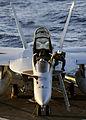 A U.S. Navy pilot and flight officer depart an F-A-18F Super Hornet aircraft after landing aboard the aircraft carrier USS Theodore Roosevelt (CVN 71) while underway in the Atlantic Ocean Sept 080921-N-AT895-017.jpg
