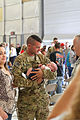 A U.S. Soldier with Golf Company, 2nd Battalion, 135th Aviation Regiment, Kansas Army National Guard holds his child during a homecoming ceremony Sept 140907-Z-VX744-755.jpg