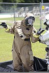 A member of the Marine Corps Air Station Beaufort fire department is helped out of his HAZMAT suit as he goes through a decontamination center at the sight chemical spill at the training pool at Marine Corps Air 130719-M-VR358-105.jpg