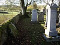 A millstone at rest in the Cemetery by Essie - geograph.org.uk - 1033634.jpg