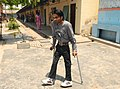 A physically challenged voter coming out after casting his vote at a polling booth in Dallupura, Delhi, UP border, during the 4th phase of General Election-2009, on May 07, 2009.jpg