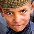 A small boy tries to look mean for the camera in Afghanistan (edited).jpg