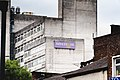 A white building with the Manchester University Logo on it. - 50140690076.jpg