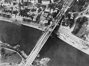 Battle of Arnhem - Aerial reconnaissance photo of the Arnhem road bridge taken by the Royal Air Force on 19 September, showing signs of the British defence on the northern ramp and the wrecked German vehicles from the previous day's fighting.