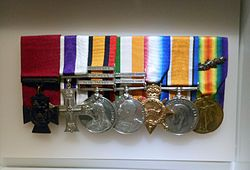 A group of seven court-mounted military decorations and medals.