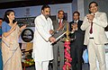 Anand Sharma lighting the lamp to inaugurate the Hastkala Conclave –Retail Summit, in New Delhi on August 17, 2012. The Secretary, Ministry of Textiles, Smt. Kiran Dhingra is also seen.jpg