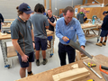 Andrew Wallace MP sawing wood at the Sunshine Coast Technical Trade Training Centre in May 2020.png