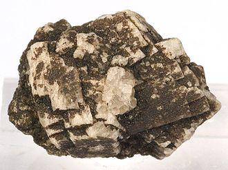 Anorthite - Anorthite crystals (white) in lava from Miyake Island, Japan (size: 2.4 x 1.7 x 1.7 cm)