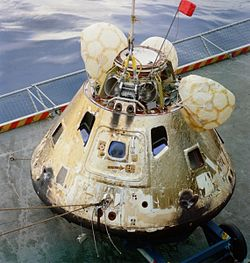 The Apollo 8 Command Module on the deck of the USS Yorktown