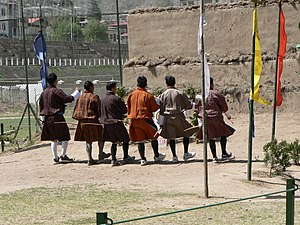 Archery in Bhutan - Archers dancing to celebrate a bullseye