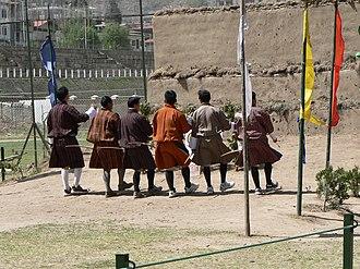 Sports in Bhutan - Archers dancing to celebrate a bullseye.