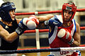 Army Capt. Boyd Melson throws a right hook against H. Rawshan of Uzbekistan during the Military World Games Boxing competition in Hyderabad.JPG