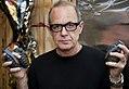 Artist Simon Raab Holding Grenades.jpg