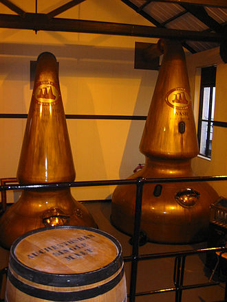 Whisky - Copper pot stills at Auchentoshan Distillery in Scotland