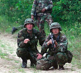 U.S. Woodland - U.S. Army National Guardsmen on an exercise in 2000 while wearing Woodland BDUs and PASGT helmets