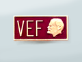 Badge (option). VEF plant named after V.I. Lenin.png