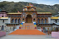 image showing Badrinath temple with mountain in the background